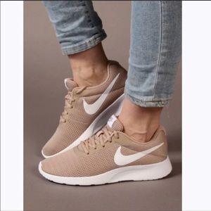 EUC Nike Tanjun women's nude running shoes